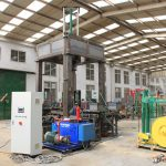 Automatic wire coil compacting and wrapping machine